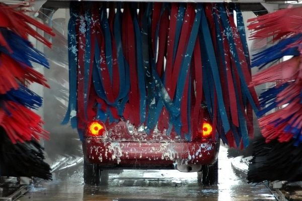 A car driving through an automated car wash