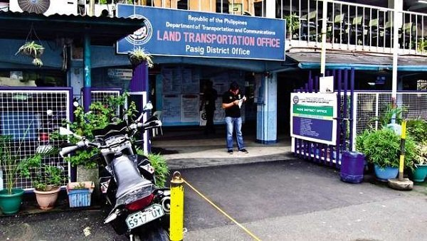 An LTO office with a man standing on the entrance
