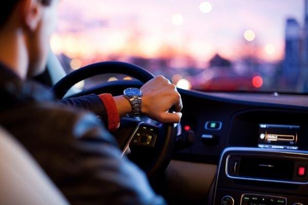 A man driving his car