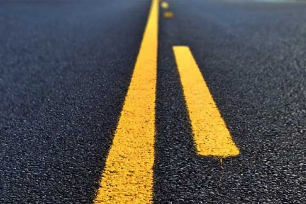 A picture of a solid yellow line with broken yellow lines.