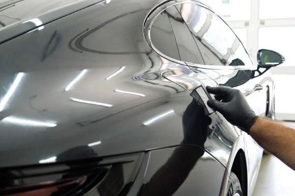 A man coating a black car