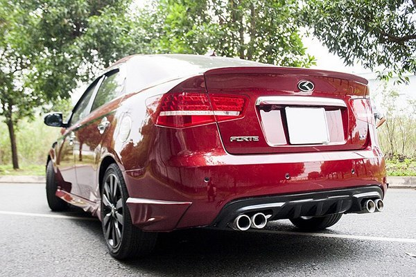 A red car with quad exhaust pipes