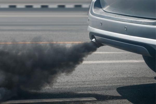 A car emitting black smoke