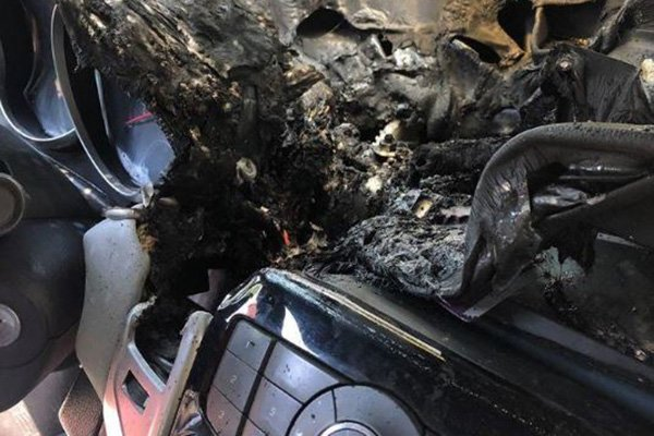 A picture of a car interior fire damage.