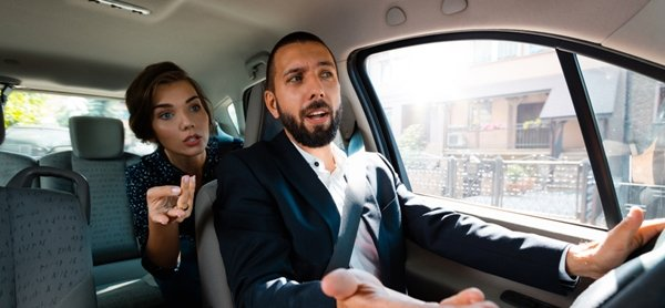 woman telling man how to drive