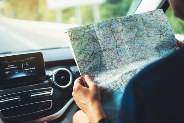 reading map on car