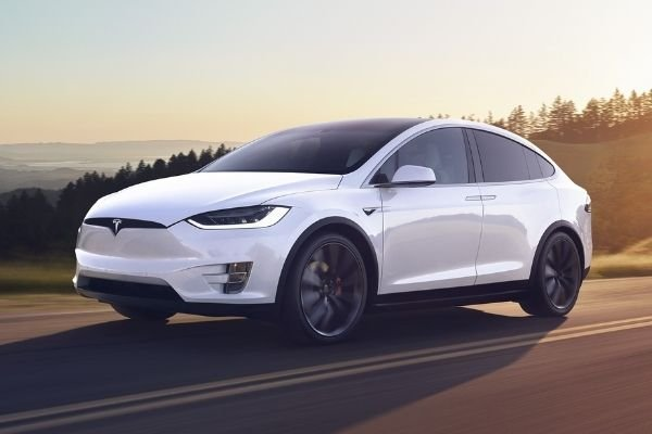 A Model X running down a road