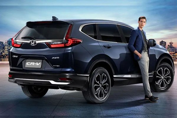 A picture of a man with the 2021 Honda CR-V.