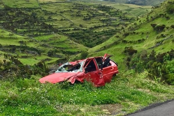 Red car crashed by a mountain