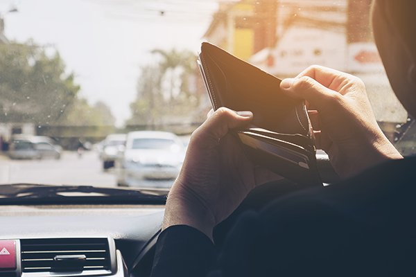 A picture of a person inspecting his/her empty wallet.
