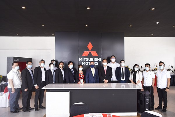 A picture of MMPC and MZM executives at the opening of the new Batangas City Mitsubishi dealership.