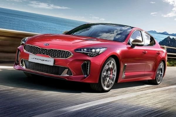 A picture of the Kia Stinger GT on the road.