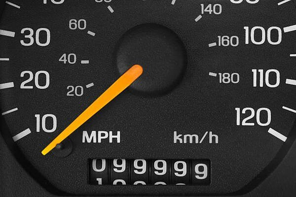 A black analog mileage of a car