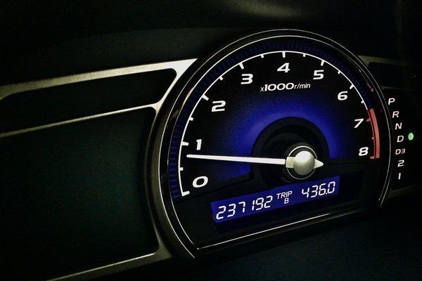 A digital mileage on a car