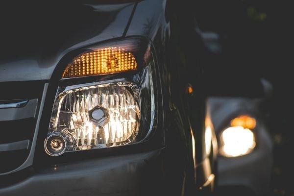 A vehicle illuminating its headlights