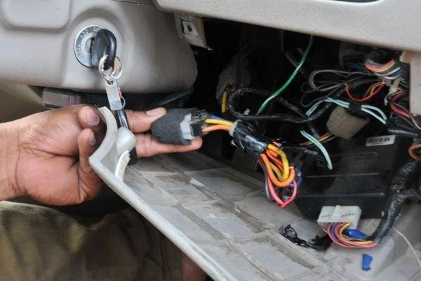 Wiring system of a car underneath its dash