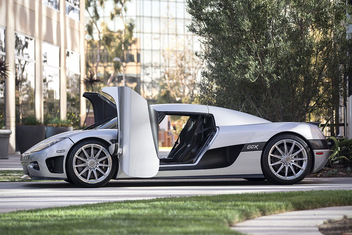 A picture of the side of the Koenigsegg CCX with its doors open