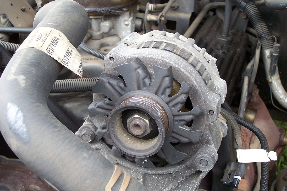 A picture of a car's alternator.