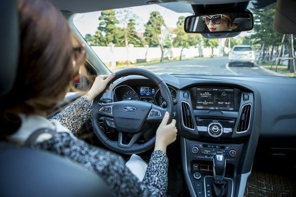 Woman holding a steering wheel