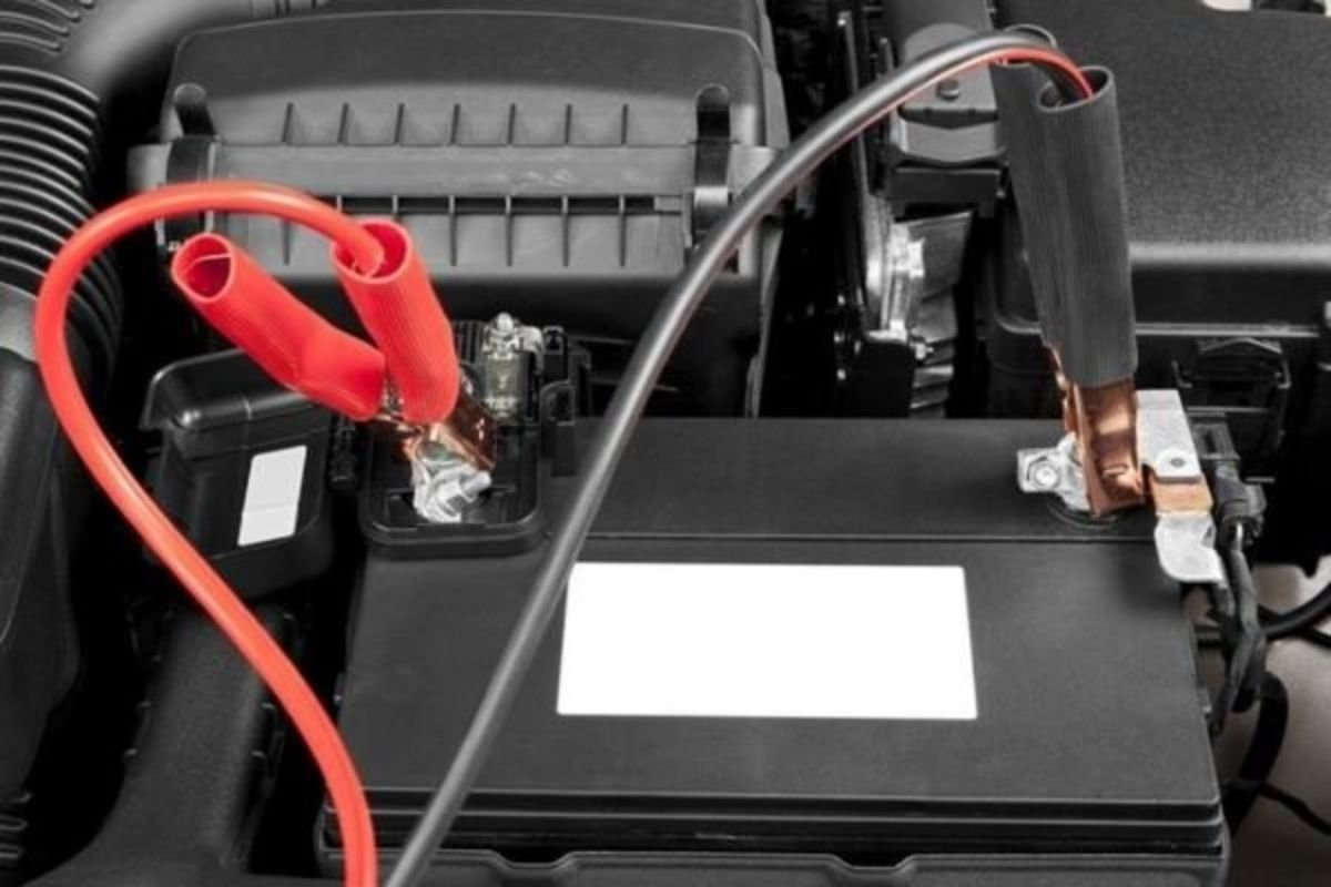 A picture of a car battery with jumper cables