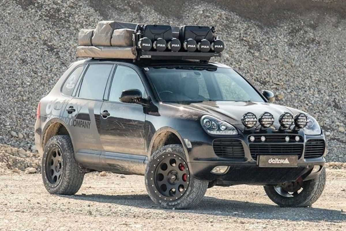 A picture of a Porsche Cayenne with a suspension lift kit in the desert