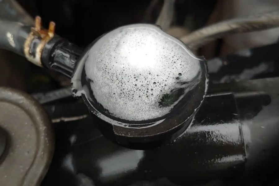 A picture of coolant bubbling out of coolant reservoir