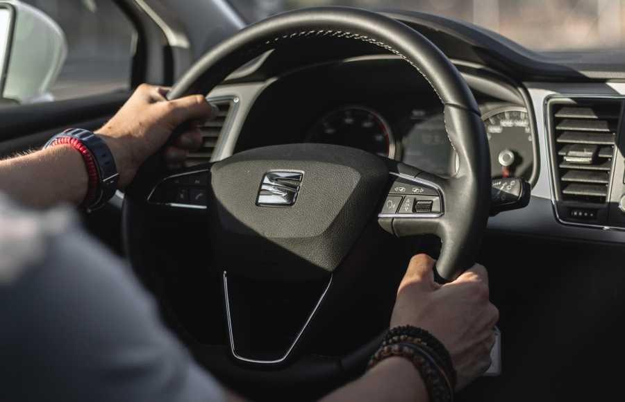 Driver holding steering wheel