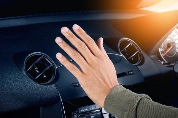 Hand checking air temperature