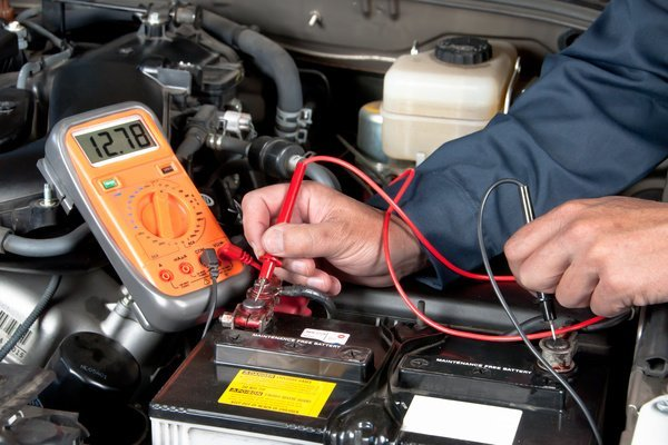 Checking a car battery's voltage using a multimeter