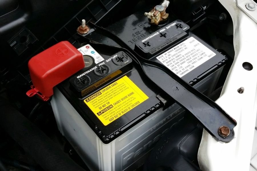 A car battery in an engine bay