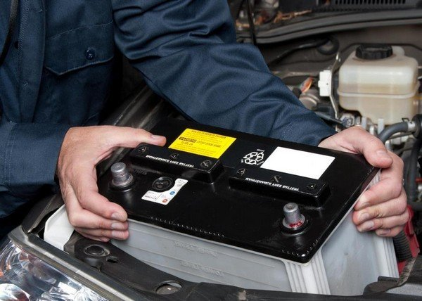 Car battery in an engine bay