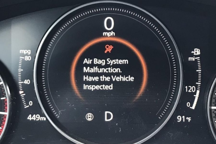 A picture of an airbag warning on a car's multi-information display