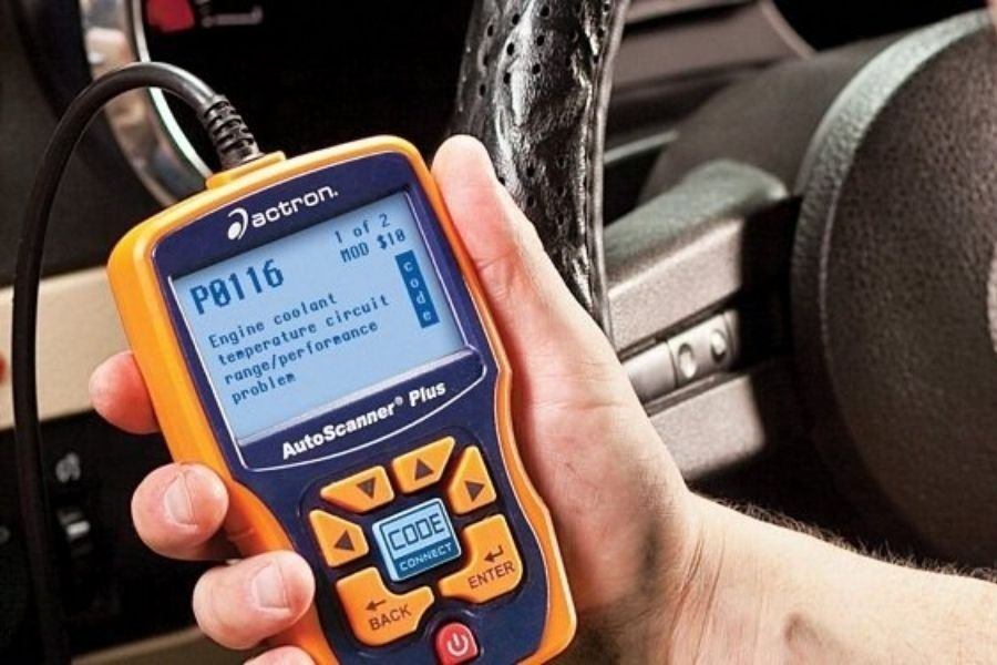 A picture of an OBD-II being used