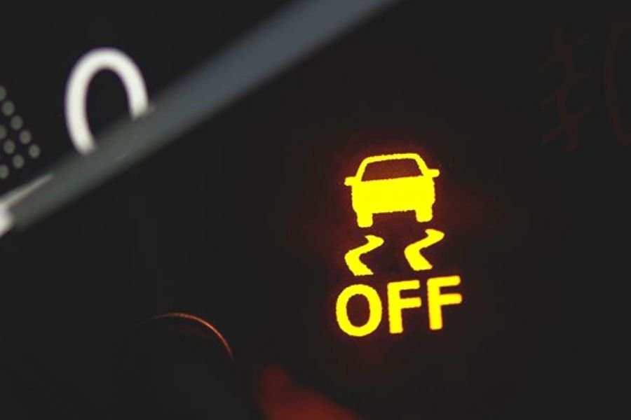 A picture of a car stability pilot light turned on