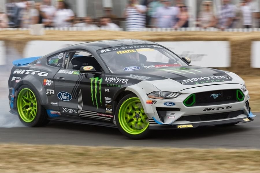 A picture of a Ford Mustang drifting at Goodwood