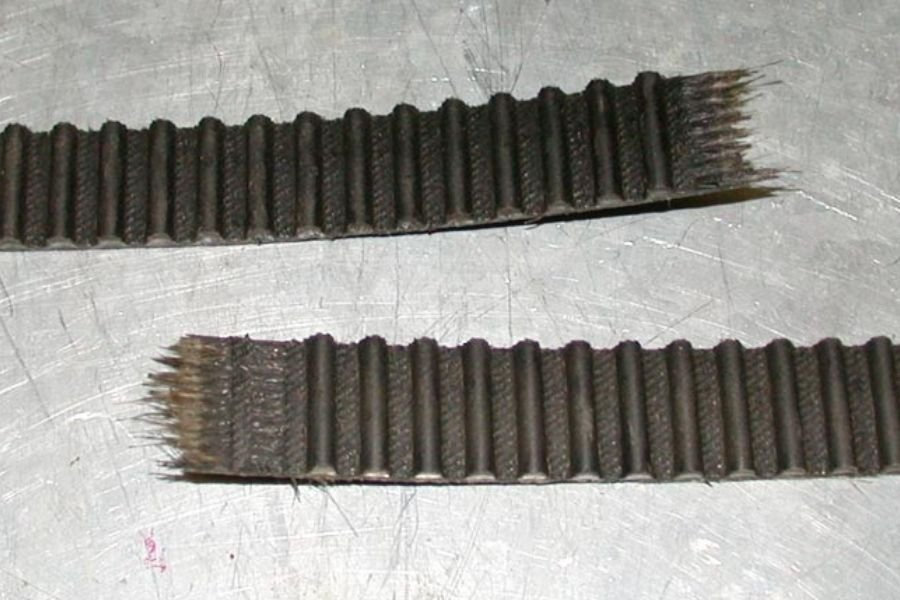 A picture of a timing belt that snapped