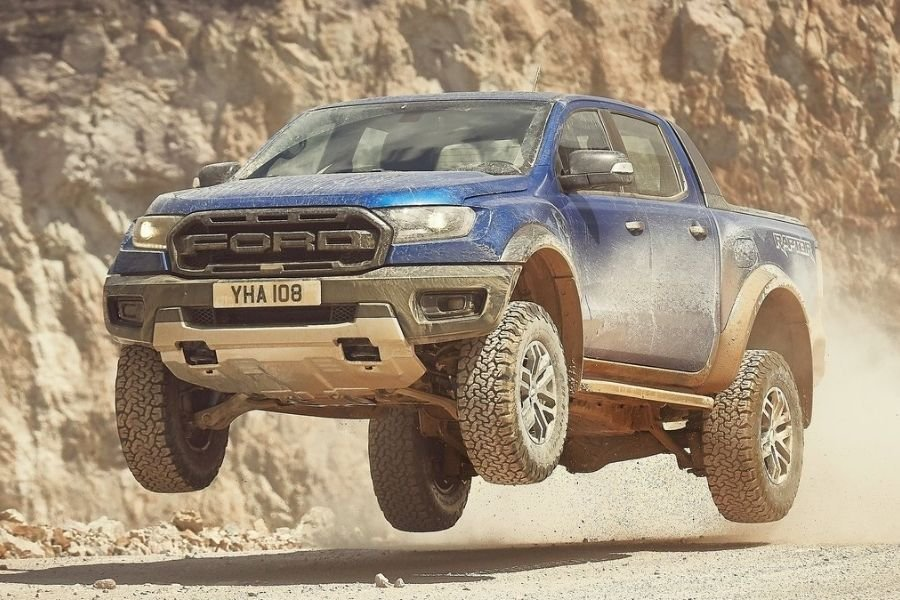 A picture of a Ford Ranger Raptor mid-jump