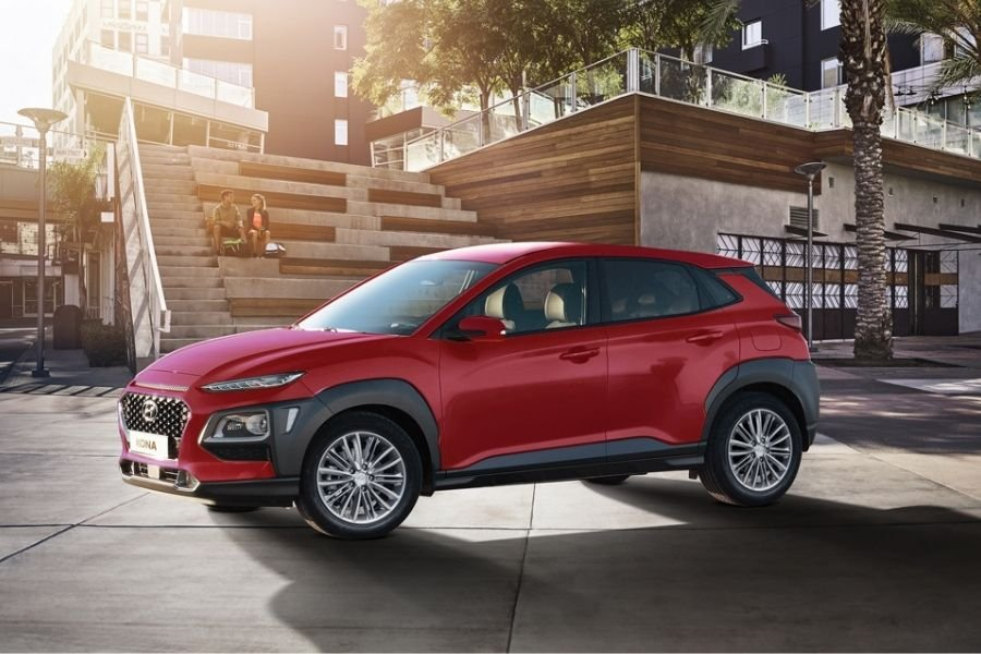 A picture of a Hyundai Kona parked in the city