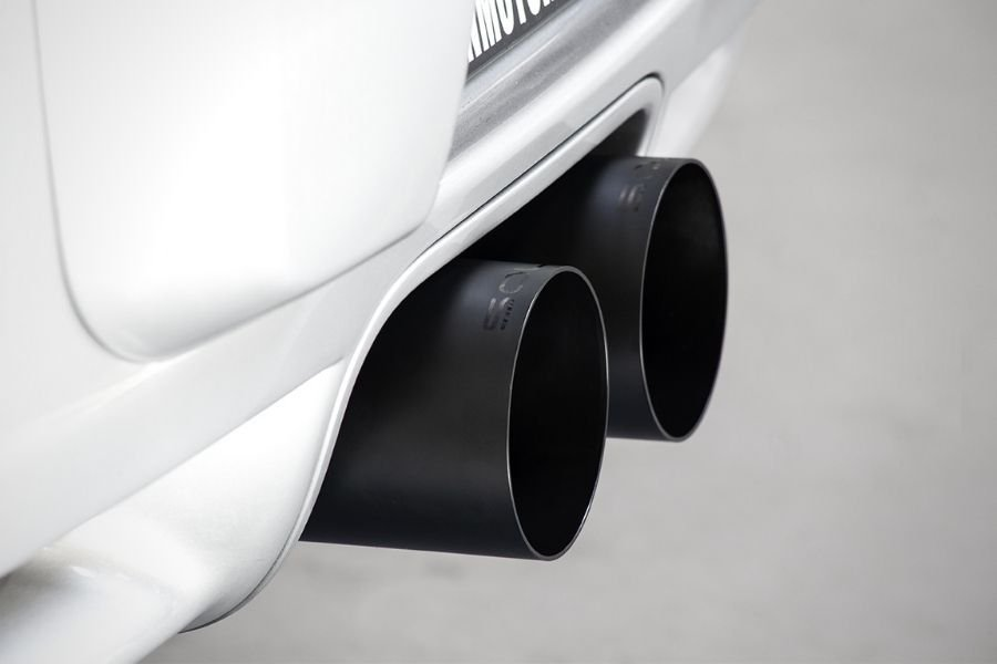 A picture of a Porsche Cayman's aftermarket exhaust outlets
