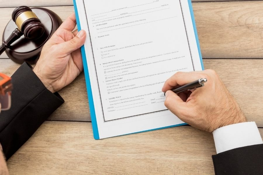 A picture of a notary signing a paper