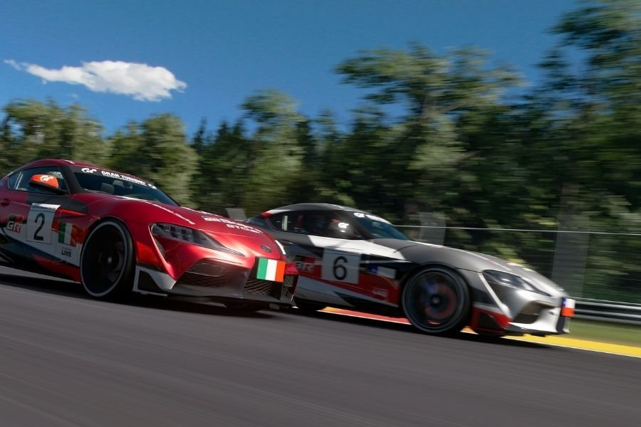 A picture of two Toyota Supras racing in Gran Turismo Sport