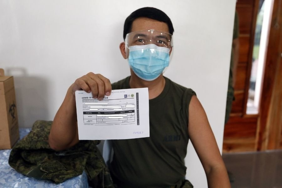 Soldier with vaccination card
