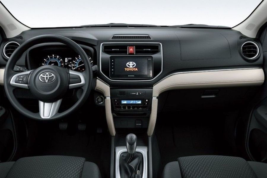 The Toyota Rush's interior highlighting the steering wheel and dashboard