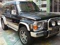 1997 Nissan Patrol Safari GQ Black 4x4 MT-5
