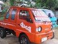 Suzuki Multicab Scrum Pickup Type 4x4 Orange For Sale -0