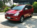 Selling Red Toyota Innova 2006 Automatic Gasoline in Candoni -2