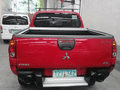 Selling Red Mitsubishi Strada 2011 Truck in Quezon City -1