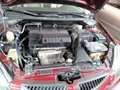 Red 2004 Mitsubishi Lancer for sale in Quezon City -2