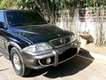 Black Ssangyong Musso 2006 for sale in Cebu City-9