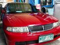 Red Mitsubishi Lancer 2001 for sale in Quezon City-9